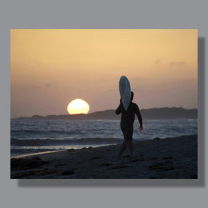 Image: Surfer on San Onofre Beach at sunset